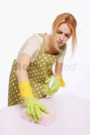 Housewife : Woman spraying and wiping table