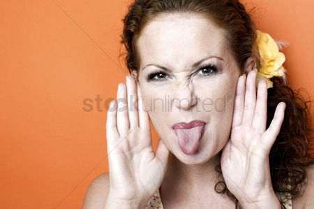 Head shot : Woman sticking out her tongue