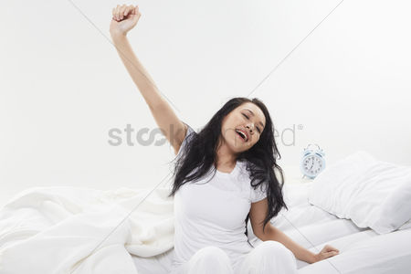 Malay : Woman stretching on her bed