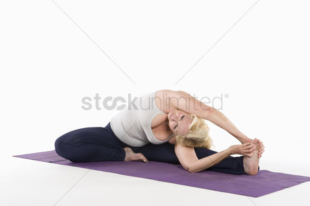 Fitness : Woman stretching while doing yoga