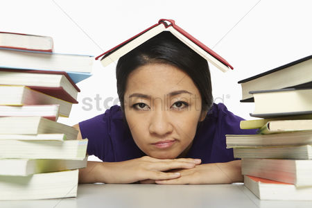 Individuality : Woman surrounded by books  looking bored