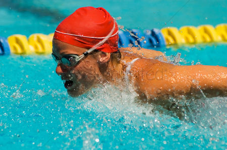 Swimmer : Woman swimming butterfly stroke  close-up