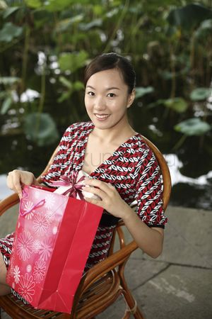 Birthday present : Woman taking out present from paperbag