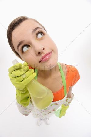 Housewife : Woman thinking while holding spray bottle