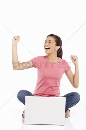 Portability : Woman using laptop and cheering