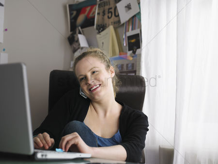 Office worker : Woman using laptop sitting at office