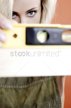 Composed : Woman using spirit level