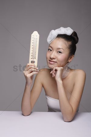 Thermometer : Woman wearing foam net accessories holding thermometer