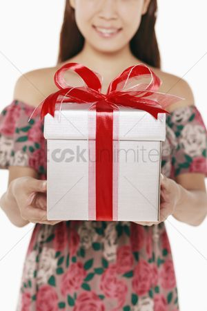 Birthday present : Woman with a box of wrapped gift