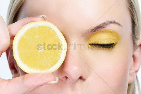 British ethnicity : Woman with a slice of lemon