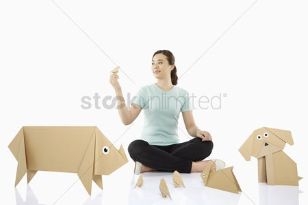 Variety : Woman with an assortment of paper animals