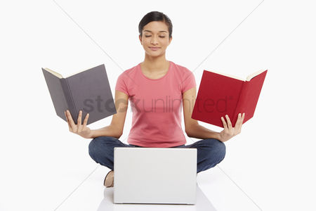 Portability : Woman with books and a laptop  meditating