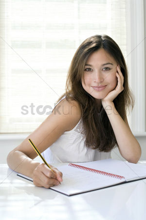 Notebook : Woman working at her desk in a home office