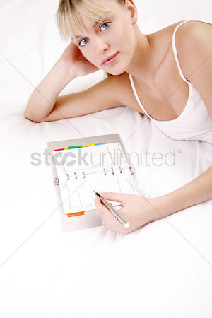 Notepad : Woman writing down her plans on the organizer