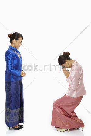 Respect : Women in traditional clothing greeting one another