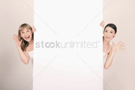 Cardboard cutout : Women peeking out from behind blank placard with hand gestures