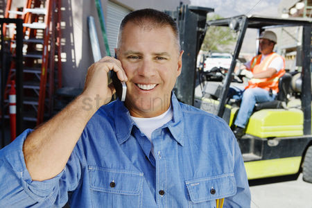 Posed : Workman talking on a cell phone