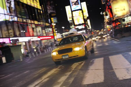 Transportation : Yellow taxi on city street at night