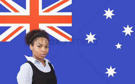 Respect : Young african american businesswoman smiling over australian flag