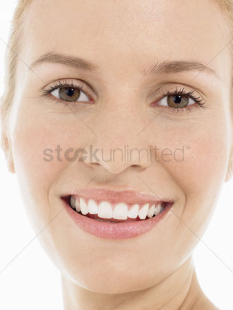 Head shot : Young blonde woman smiling portrait close up