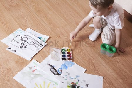 Paint brush : Young boy with paintbox