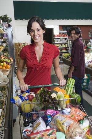 Pushing : Young couple food shopping in supermarket