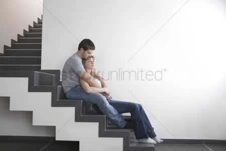 Stairs : Young couple sit on staircase  copyspace