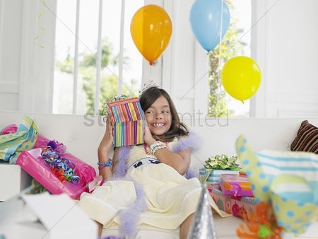 Birthday present : Young girl  7-9  opening birthday presents