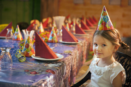 Czech republic : Young girl seated at her birthday table