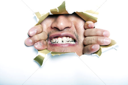 Smile : Young korean man looking through ripped paper hole