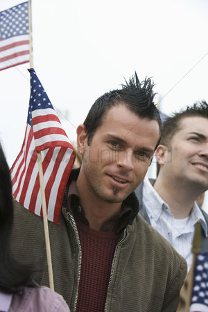 Demonstration : Young man holding american flag portrait