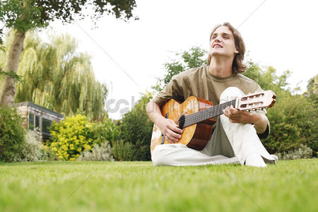 Hobby : Young man playing the guitar