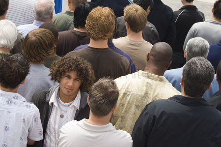 Women group outside : Young man standing in crowd
