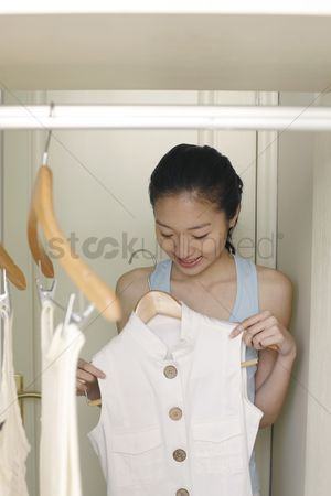 Choosing : Young woman choosing clothes in the wardrobe