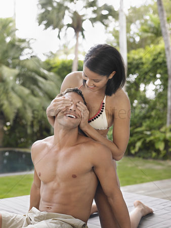 Gladness : Young woman covering man s eyes