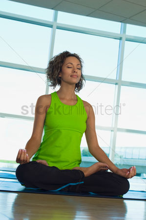 Fitness : Young woman doing yoga indoors