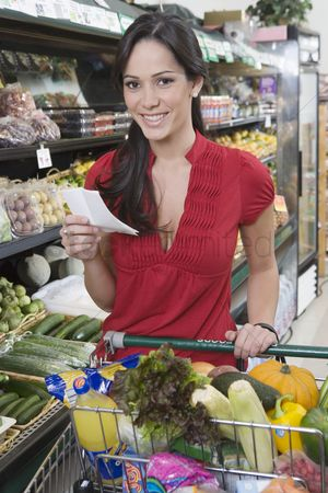 Shopping : Young woman food shopping in supermarket