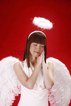 Religion : Young woman in angel costume