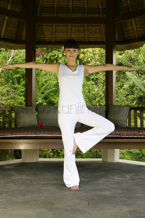 Interior : Young woman practising yoga