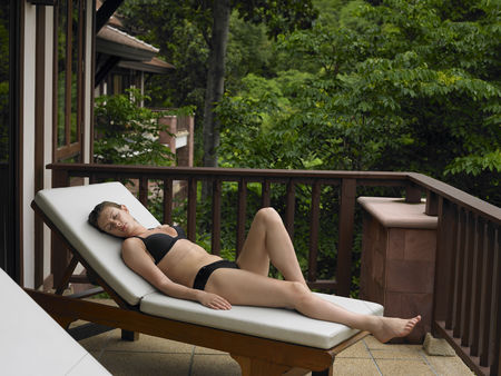 Comfy : Young woman reclining in deck chair