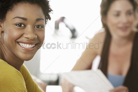 Women : Young woman smiling in office meeting portrait