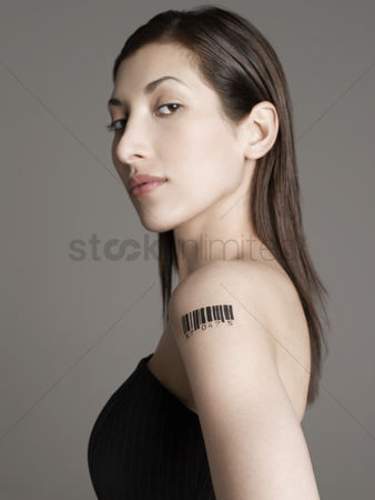 Arm raised : Young woman with bar code tattoo on her arm