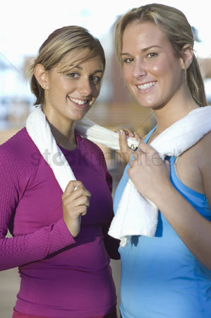 Workout : Young women holding towels after exercising